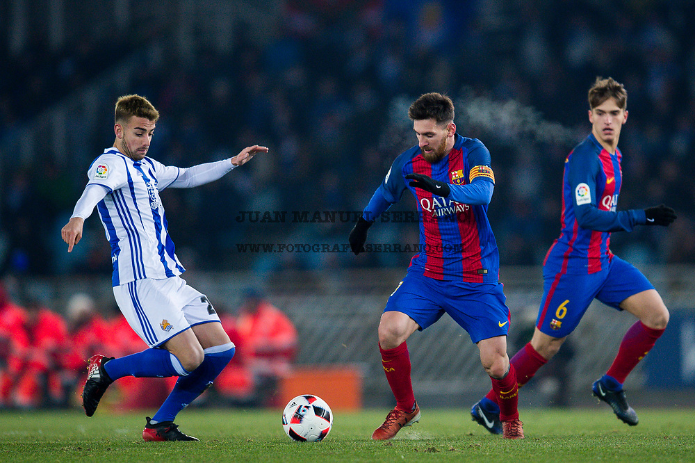 SAN SEBASTIAN, SPAIN - JANUARY 19:  Lionel Messi of FC Barcelona duels for the ball with David Concha of Real Sociedad during the Copa del Rey Quarter Final, First Leg match between Real Sociedad de Futbol and FC Barcelona at Estadio Anoeta on January 19, 2017 in San Sebastian, Spain.  (Photo by Juan Manuel Serrano Arce/Getty Images)