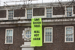 A banner reading 'Save Euston Trees - Heal Not Harm' hangs from the Friends House on Euston Road on 6th February 2021 in London, United Kingdom. The banner was hung by environmental activists from anti-HS2 campaign group HS2 Rebellion in solidarity with fellow activists occupying tunnels beneath Euston Square Gardens in order to seek to protect trees from felling in connection with the HS2 high-speed rail project.
