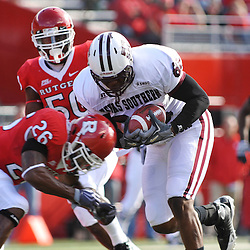 Oct 10, 2009; Piscataway, NJ, USA; Rutgers cornerback Joe Lefeged (26) hits Texas Southern tight end Jonathan Hannah (88) during first half NCAA college football action between Rutgers and Texas Southern at Rutgers Stadium.