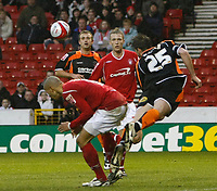 Photo: Richard Lane/Richard Lane Photography. Nottingham Forest v Blackpool. Coca Cola Championship. 13/12/2008. Nathan Tyson (L) ducks as Shaun Barker (R) heads clear