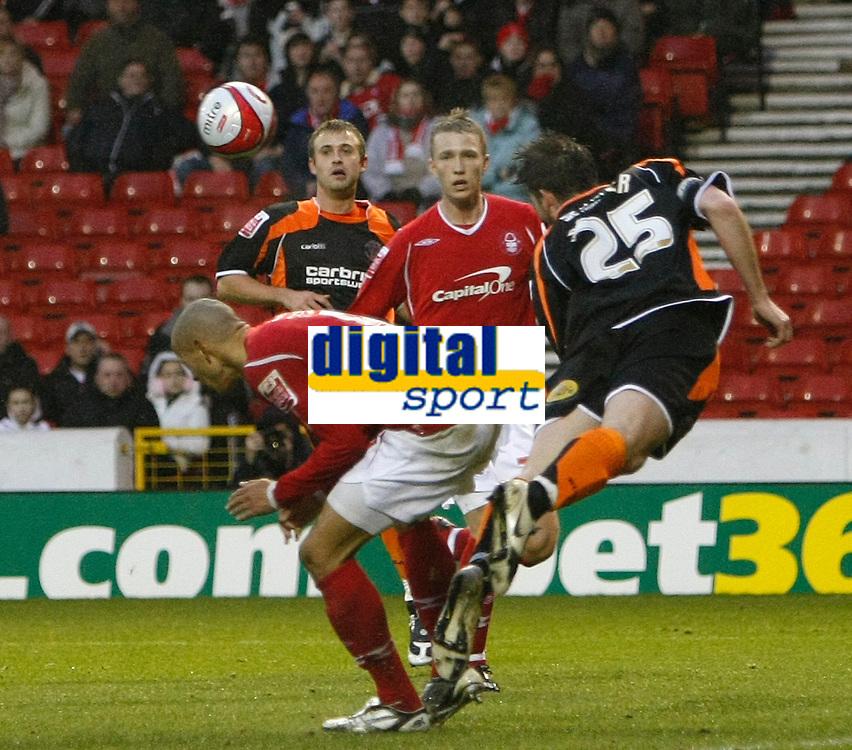 Photo: Richard Lane/Richard Lane Photography. Nottingham Forest v Blackpool. Coca Cola Championship. 13/12/2008. Nathan Tyson (L) ducks as Shaun Barker (R) heads clear