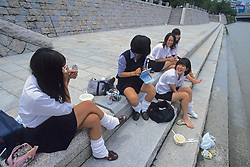 Girls Putting On Make-up By Riverside