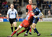 Sale Sharks scrum-half Will Cliff is tackled by Leicester Tigers wing Jordan Olowofela during a Gallagher Premiership Rugby Union match Sale Sharks -V- Leicester Tigers, Sale won 36-3 on Friday, Feb. 21, 2020, in Eccles, United Kingdom. (Steve Flynn/Image of Sport via AP)