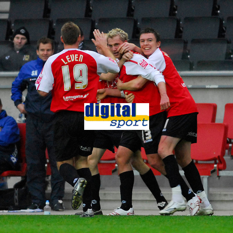 Photo: Leigh Quinnell/Sportsbeat Images.<br /> Milton Keynes Dons v Chesterfield. Coca Cola League 2. 24/11/2007. Chesterfields Felix Bastians (13) is congratulated on his goal by his team mates.