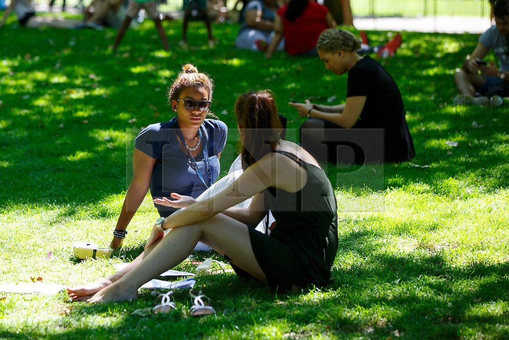 © Licensed to London News Pictures. 19/07/2016. London, UK. People enjoy the hottest day of the year so far in the UK in St James's Park in London on Tuesday, 19 July 2016. Photo credit: Tolga Akmen/LNP