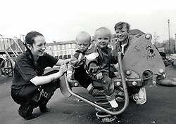 Young mothers with toddlers in playground, UK 1989
