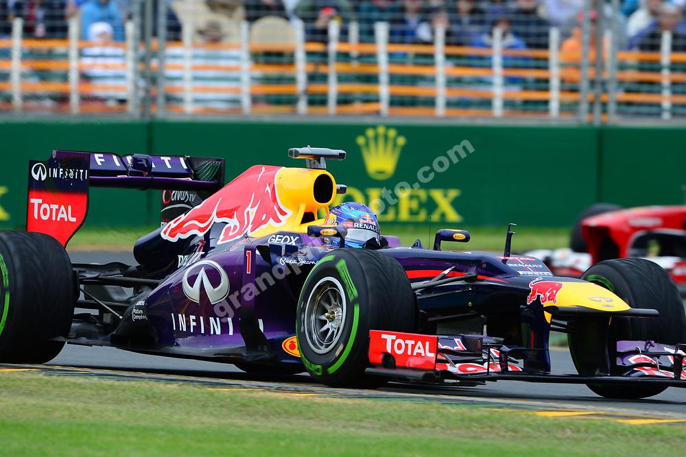 Sebastian Vettel (Red Bull-Renault) leading a Ferrari during wet qualifying for the 2013 Australian Grand Prix in Albert Park, Melbourne. Photo: Grand Prix Photo