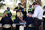 MELBOURNE, VIC - SEPTEMBER 19: Police are seen processing protesters who have been arrested during the Freedom protest on September 19, 2020 in Melbourne, Australia. Freedom protests are being held in Melbourne every Saturday and Sunday in response to the governments COVID-19 restrictions and continuing removal of liberties despite new cases being on the decline. Victoria recorded a further 21 new cases overnight along with 7 deaths. (Photo by Dave Hewison/Speed Media)