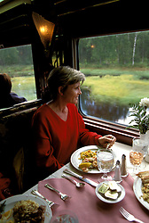 AK: Alaska Railroad, Dining on the McKinley Explorer Train, model released.   .Photo Copyright Lee Foster, lee@fostertravel.com, www.fostertravel.com, (510) 549-2202.Image: akdena223