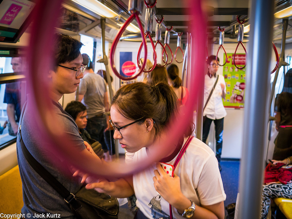 """04 APRIL 2013 - BANGKOK, THAILAND:  Commuters ride the BTS Skytrain in Bangkok. The Skytrain is one of Bangkok's """"soft targets"""" as there is no security on the trains and only cursory security in the stations. The United States' Federal Bureau of Investigation (FBI)  has warned the Thai government that Thailand has the greatest risk of a terror attack in Asia and the fifth greatest in the world. According to a statement from the Thai government the assessment is based on Thailand's relative freedoms and ease of movement in Thailand. In response to the report, Deputy Prime Minister Chalerm Yubamrung announced plans to set up an anti-terror center in Bangkok and work with Thai immigration to institute tougher screening on foreigners entering Thailand. In February 2012, terrorists thought to be connected with the Iranian government were arrested in Bangkok after the house they were living in blew up. At the time, Thai authorities said they suspected it was a bomb factory.     PHOTO BY JACK KURTZ"""
