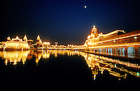 Night scene of the grounds of the Golden Temple (holiest Sikh shrine), Amritsar, Punjab, India