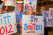 28 FEBRUARY 2012 - PHOENIX, AZ:     Mitt Romney supporters cheer when primary election results from the Arizona show Romney winning the state are flashed on a TV screen. Several hundred Romney supporters crowded into a ballroom in a Phoenix hotel to watch primary results from Michigan and Arizona. Romney won the night, scoring a tight win in the Michigan Republican Presidential primary and a comfortable win in the Arizona Republican Presidential primary.    PHOTO BY JACK KURTZ