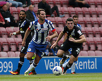 Wigan Athletic's Nick Powell is chased down by Blackburn Rovers' Darragh Lenihan<br /> <br /> Photographer David Shipman/CameraSport<br /> <br /> Football - The EFL Sky Bet Championship - Wigan Athletic v Blackburn Rovers - Saturday 13th August 2016 - DW Stadium - Wigan<br /> <br /> World Copyright © 2016 CameraSport. All rights reserved. 43 Linden Ave. Countesthorpe. Leicester. England. LE8 5PG - Tel: +44 (0) 116 277 4147 - admin@camerasport.com - www.camerasport.com