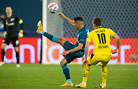 SAINT PETERSBURG, RUSSIA - DECEMBER 08: Douglas Santos of Zenit St. Petersburg flicks the ball over Thorgan Hazard of Borussia Dortmund during the UEFA Champions League Group F stage match between Zenit St. Petersburg and Borussia Dortmund at Gazprom Arena on December 8, 2020 in Saint Petersburg, Russia. (Photo by MB Media)