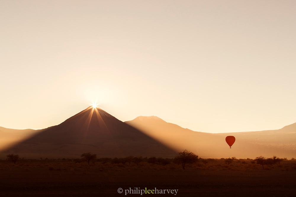 Hot air balloon at sunrise in Atacama Desert, Chile