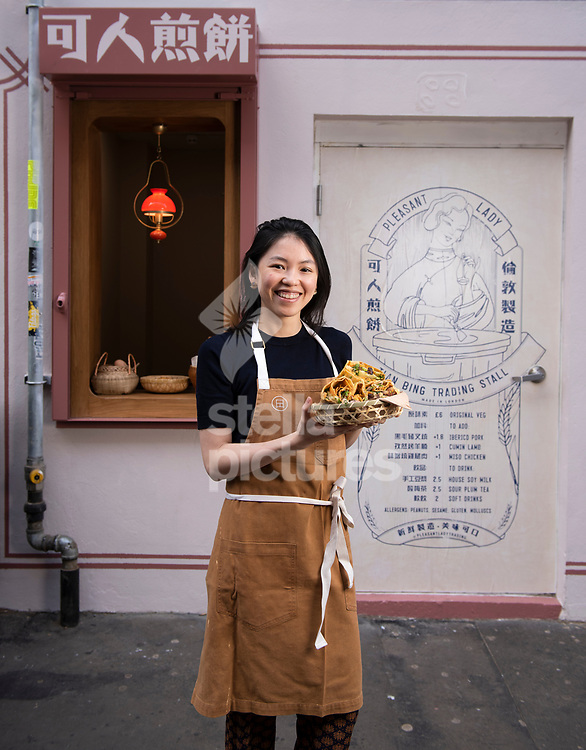 Z He, co founder of Pleasant Lady Jian Bing Trading Stall in Soho.<br /> Pleasant Lady Jian Bing Trading Stall is a 'hatch' - a window reminiscent of the street carts of Canton service Jian bing, selling a traditional crispy chinese Crepe filled with spicy tomato sauce, veggies and a host of toppings.<br /> Picture by Daniel Hambury/@stellapicsltd 07813022858<br /> 16/04/2018