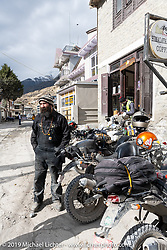 Spoke and Dagger's Chris Drew heading back out on the road after a chai stop at the Himalayan Java Coffee House in Jomsom during Motorcycle Sherpa's Ride to the Heavens motorcycle adventure in the Himalayas of Nepal. On the fifth day of riding, we went from Muktinath to Tatopani. Friday, November 8, 2019. Photography ©2019 Michael Lichter.