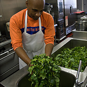 """Volunteer washing collard greens three times in kitchen sink, food for Thanksgiving being prepared a week in advance in Sister Jean's Kitchen. .A former casino chef, Webster, 74, found her calling when she saw a man rummaging through a garbage can in search of food. Now she runs a soup kitchen that feeds up to 400 homeless people a day, five days a week in the dinning room of the First Presbyterian Church of Atlantic City. No one is turned away. Jean has been called """"Sister Jean"""" or """"Saint Jean"""" or """"the Mother Teresa of Jersey."""""""