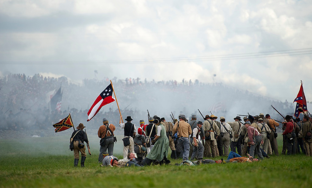 Confederate soldiers march towards the Union lines during a staging of Pickett's Charge the finale of a four day Gettysburg Anniversary Committee 150th Gettysburg reenactment in Gettysburg, PA on July 7, 2013.