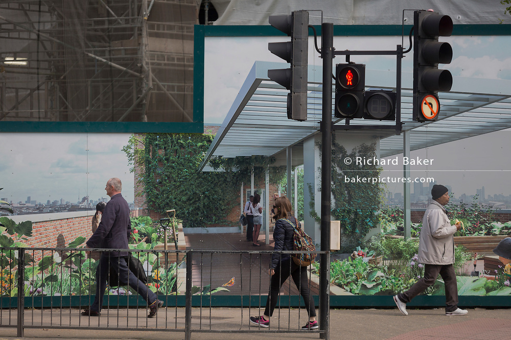 Passers-by and a marketing hoarding for the newest delvelopment at Elephant and Castle called Elephant Park, on 25th April 2018, in London, England.