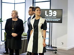 © Licensed to London News Pictures . H.R.H. Crown Princess Victoria and H.R.H. Prince Daniel, with  Sweden's Minister for Trade Ewa Björling, left, visit  Level39, Europe's largest FinTech accelerator space, at Canary Wharf, London. (07/11/2013) . Photo credit : LNP