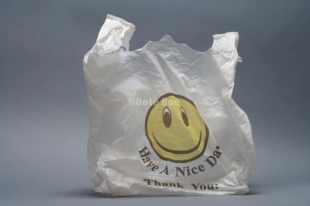 plastic bag with smiling face and text printed on it