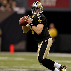 2009 November 30: New Orleans Saints quarterback Drew Brees (9) looks to throw during a 38-17 win by the New Orleans Saints over the New England Patriots at the Louisiana Superdome in New Orleans, Louisiana.