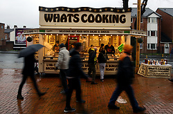 Fans arrive at the ground and buy food from a Whats Cooking food store before the Premier League match at Molineux, Wolverhampton.