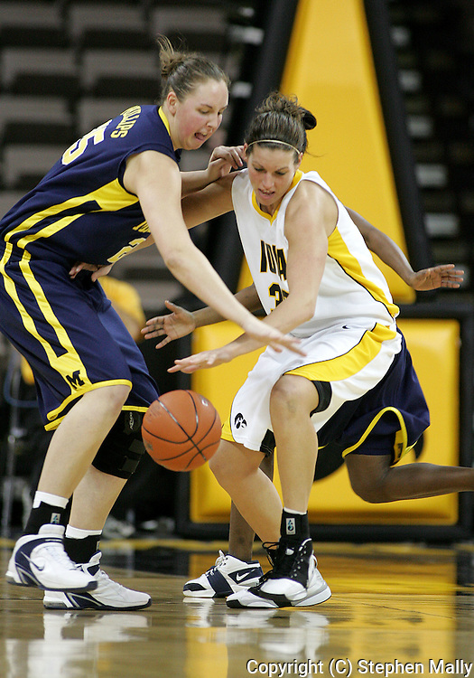 08 February 2007: Michigan center Krista Phillips (25) and Iowa forward Wendy Ausdemore (32) try to control the ball in Iowa's 66-49 win over Michigan at Carver-Hawkeye Arena in Iowa City, Iowa on February 8, 2007.