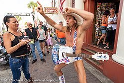 The Naked Cowboy came down from New York to strum Main Street during Daytona Beach Bike Week, FL. USA. Friday, March 15, 2019. Photography ©2019 Michael Lichter.