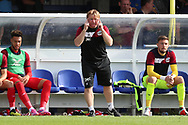 Scunthorpe United manager Stuart McCall with fingers to his head during the EFL Sky Bet League 1 match between AFC Wimbledon and Scunthorpe United at the Cherry Red Records Stadium, Kingston, England on 15 September 2018.