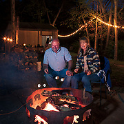 """Randy and Leslie Liles cook s'mores on a fire at their """"glamping"""" tent experience on their property that sits next to a creek in Kingston Springs, Tennessee. Nathan Lambrecht/Journal Communications"""
