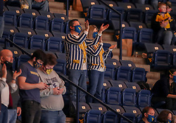 Feb 13, 2021; Morgantown, West Virginia, USA; West Virginia Mountaineers fans cheer during the second half against the Oklahoma Sooners at WVU Coliseum. Mandatory Credit: Ben Queen-USA TODAY Sports