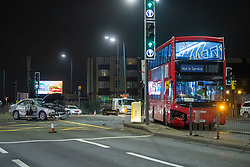 © Licensed to London News Pictures. 30/01/2021. London, UK. A damaged silver Mercedes car and double decker bus on the A40. A road traffic collision between a car and a bus closed the busy A40 at the junction of Wales Farm Road in Acton, the collision occurred at approximately 22:30GMT. Photo credit: Peter Manning/LNP