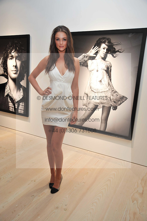 LAUREN BUDD (Model name Violet Budd) at an exhibition of photographic portraits by Bryan Adams entitled 'Hear The World' at The Saatchi Gallery, King's Road, London on 21st July 2009.