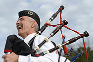Reginald Lyle, a bagpiper with the Rosie O'Grady's Highlanders, has a laugh while performing during the Central Florida Scottish Highland Games in Winter Springs, Fla., Sunday, Jan. 19, 2014.(Special to the Sentinel/Phelan M. Ebenhack)