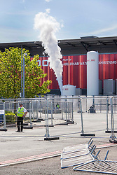© Licensed to London News Pictures. 19/05/2020. London, UK. The giant oxygen tank located at the Excel centre for the Nightingale emergency hospital is believed to be being emptied as the facility closes. The hospital was built for a capacity of 4000 beds but only a small number of Covid-19 patients were treated there. Photo credit: Marcin Nowak/LNP