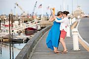 A same-sex couple dances on Macmillan Pier in Provincetown, MA.