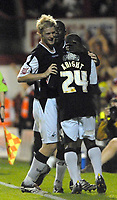 Photo: Ed Godden.<br /> Brentford v Swansea City. Coca Cola League 1. 12/09/2006. Leon Knight (centre) is congratulated by his Swansea team mates Alan Tate (L) and Kevin Austin after he scores his 2nd goal.