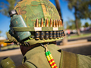 """11 NOVEMBER 2013 - PHOENIX, AZ: A Vietnam era vet prepares to march in the Phoenix Veterans Day Parade. The Phoenix Veterans Day Parade is one of the largest in the United States. Thousands of people line the 3.5 mile parade route and more than 85 units participate in the parade. The theme of this year's parade is """"saluting America's veterans.""""    PHOTO BY JACK KURTZ"""