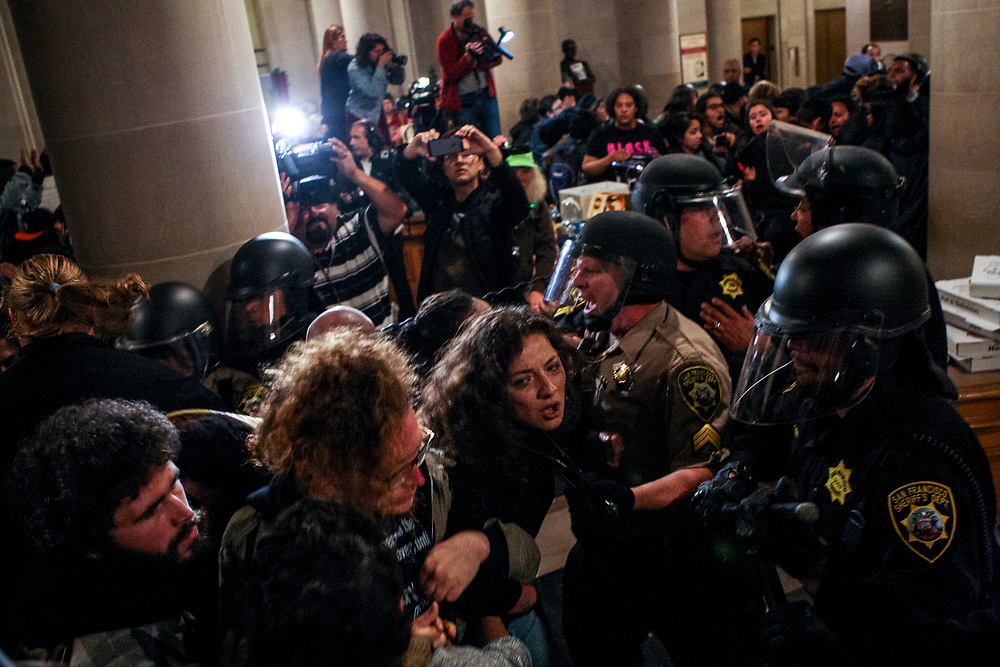 San Francisco sheriffs push out protestors occupying City Hall demanding the resignation of SFPD Chief Greg Suhr in San Francisco, Calif., Friday, May 6, 2016.<br /> <br /> The protest occurred after the Frisco 5 were hospitalized after 16 days of a hunger strike. The group called off their hunger strike a day after the City Hall protest took place. Deputy sheriffs arrested 33 protestors in addition to assaulting four journalists covering the protest that night.