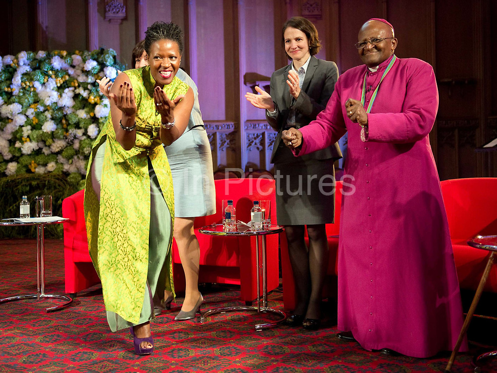 Former archbishop Desmond Tutu dances at a ceremony after receiving the 2013 Templeton Prize at the Guildhall in London, UK. His daughter Reverend Mpho Tutu (left) and Heather Templeton Dill, granddaughter of the late Sir John Templeton (centre) . South African anti-apartheid campaigner Desmond Tutu won the 2013 Templeton Prize worth $1.7 million for helping inspire people around the world by promoting forgiveness and justice.