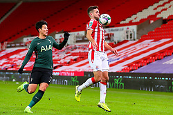 Tommy Smith of Stoke City brings the ball under control, under pressure from Son Heung-Min of Tottenham Hotspur  - Mandatory by-line: Nick Browning/JMP - 23/12/2020 - FOOTBALL - Bet365 Stadium - Stoke-on-Trent, England - Stoke City v Tottenham Hotspur - Carabao Cup