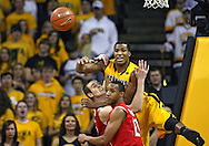 January 27, 2010: Ohio State center Kyle Madsen (15), Ohio State guard/forward Evan Turner (21), and Iowa forward Jarryd Cole (50) looks towards the ball during the first half of their game at Carver-Hawkeye Arena in Iowa City, Iowa on January 27, 2010. Ohio State defeated Iowa 65-57.