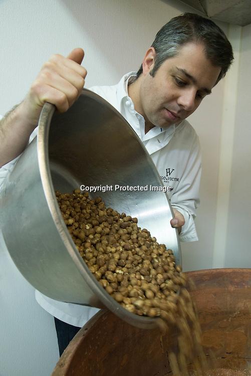 France. Paris . Chocolate Workshop of Hugo et Victor . Hugues Pouget is making Praline in a big brass Pot