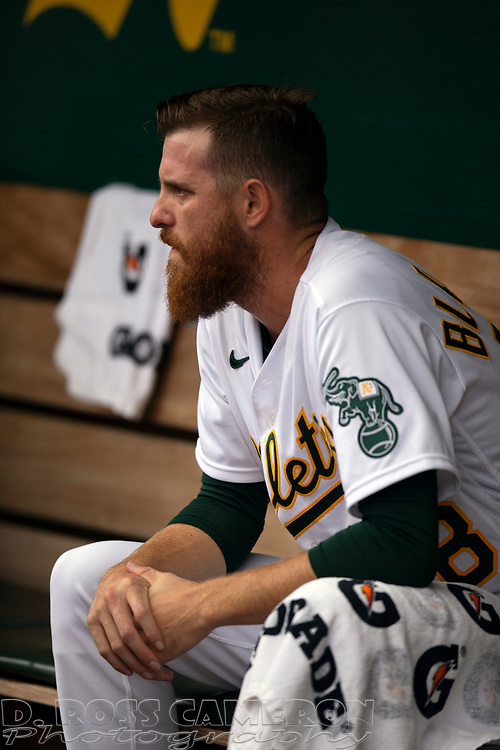 Sep 26, 2021; Oakland, California, USA; Oakland Athletics starting pitcher Paul Blackburn (58) watches his team take their turn at bat against the Houston Astros in the first inning at RingCentral Coliseum. Mandatory Credit: D. Ross Cameron-USA TODAY Sports