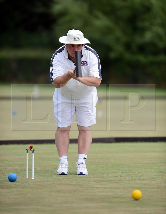 © Licensed to London News Pictures. 14/08/2013. Surbiton, UK. Robin Brown, England in action. People participate in the14th World Association Croquet Championship at the Surbiton Croquet Club, Kingston upon Thames on the 14th August 2013. The Final will be played on Sunday 18th August. 80 competitors from 20 countries are taking part. Photo credit : Mike King/LNP