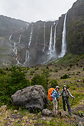 """See multiple waterfalls plunge from Castaño Overo Glacier at Mirador Castaño Overo on Cerro Tronador, an extinct stratovolcano in the southern Andes, near Bariloche, in the Lake District of Argentina, in Patagonia, South America. This viewpoint from a side trail is marked as """"Castaño Overo 1 Hour"""", an easy side trip from the longer path to Otto Meiling Refuge. The sound of falling seracs inspired the name Tronador, Spanish for """"Thunderer."""" With an altitude of 3470 m, Tronador stands more than 1000 meters above nearby mountains in the Andean massif, making it a popular climb in Patagonia, South America. Located inside two National Parks, Nahuel Huapi in Argentina and Vicente Pérez Rosales in Chile, Tronador hosts eight glaciers, which are retreating due to warming of the upper troposphere. To license this Copyright photo, please inquire at PhotoSeek.com."""