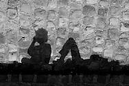 France. Paris. 4th district.  people gathering at sunset on the quai  d Orleans along the Seine river , on saint Louis Island  / rassemblement au coucher du soleil sur le quai d Orleans sur  ile Saint Louis Paris