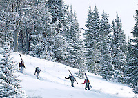 Bradly J. Boner / JACKSON HOLE DAILY.Four skiers join dozens of others in the march up Mount Glory on Tuesday morning. The parking lot at the top of Teton Pass was full by 8 a.m. as more than a foot of fresh snow caused a frenzy of powder hungry skiers and snowboarders.